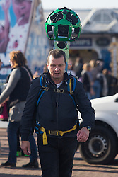 Brighton, UK. 27/10/2016, A member of the internet search giant Google walks on Brighton promenade to photograph the area and update Google Mpas. Photo Credit: Hugo Michiels
