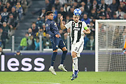 Juventus Defender Giorgio Chiellini battles in the air with a header with Manchester United Midfielder Jesse Lingard during the Champions League Group H match between Juventus FC and Manchester United at the Allianz Stadium, Turin, Italy on 7 November 2018.