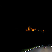Burg Lichtenberg perched and seemingly floating atop it's hill and lit up at night, with a fantastic winding dark & adventurous road below it...the Burgstraße