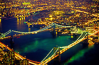 Aerial view of Brooklyn and Manhattan Bridges on the East River at twilight, New York, New York, USA