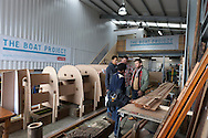 England, Emsworth, The Boat Project. 25  February  2011. Mark Covell, (centre behind)Technical Manager, The Boat Project and Greg Whelan,(right) Artistic Director, Lone Twin  show visitors around The Boat Project.