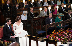 Princess Eugenie and her husband Jack Brooksbank, look back towards the Duke of York and Sarah, Duchess of York (seated front) and Queen Elizabeth II, the Duke of Edinburgh, Prince of Wales, the Duke and Duchess of Cambridge, and the Duke and Duchess of Sussex, during their wedding at St George's Chapel in Windsor Castle.