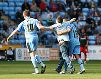 Photo: Mark Stephenson.<br />Coventry City v Queens Park Rangers. Coca Cola Championship. 07/04/2007. Coventry's Kevin Kyle (L) and Leon McMenzie escort a fan from the pitch