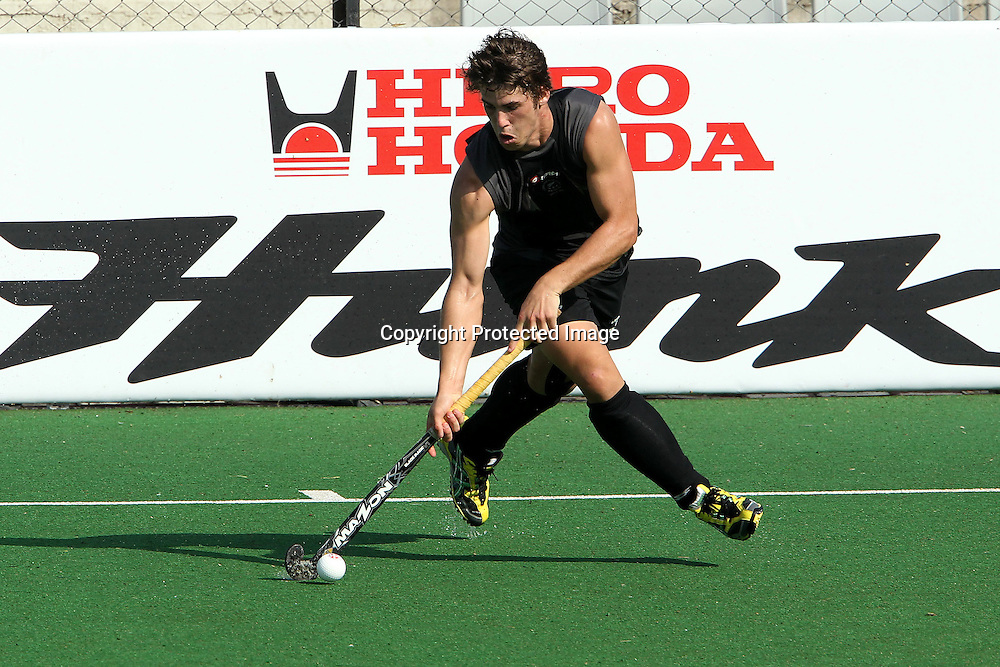 Nick Wilson of New Zealand during the hockey match between New Zealand and Canada during the XiX Commonwealth Games  held at the MDC Stadium in New Delhi, India on the  10 October 2010<br /> <br /> Photo by:  Ron Gaunt/photosport.co.nz