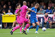 AFC Wimbledon attacker Marcus Forss (15) battles for possession with Rochadale attacker Calvin Andrew (9) during the EFL Sky Bet League 1 match between AFC Wimbledon and Rochdale at the Cherry Red Records Stadium, Kingston, England on 5 October 2019.