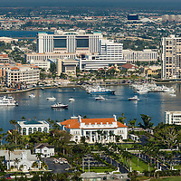 Aerial view of The Flagler Museum on Palm Beach with the Intracoastal Waterway, West Palm marinas, condominiums and new government center in the background.