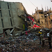 Rana Plaza 8 Storey Building collapsed in  around 8.45 morning on 24 April 2013 in Savar outskirt of Dhaka,Bangladesh. <br /> <br /> The building had 5 Garments, 1 bank and many shops. <br /> <br /> At least 400 killed and thousand inured  <br /> <br /> 28,29,30 April 2013