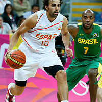 06 August 2012: Spain Victor Sada drives past Brazil Larry Taylor during 88-82 Team Brazil victory over Team Spain, during the men's basketball preliminary, at the Basketball Arena, in London, Great Britain.
