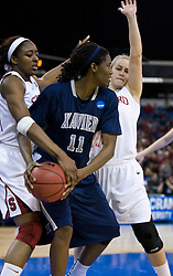 March 29, 2010; Sacramento, CA, USA; Stanford Cardinal forward Nnemkadi Ogwumike (30) steals the ball from Xavier Musketeers forward Amber Harris (11) during the second half in the finals of the Sacramental regional in the 2010 NCAA womens basketball tournament at ARCO Arena. Stanford defeated Xavier 55-53.
