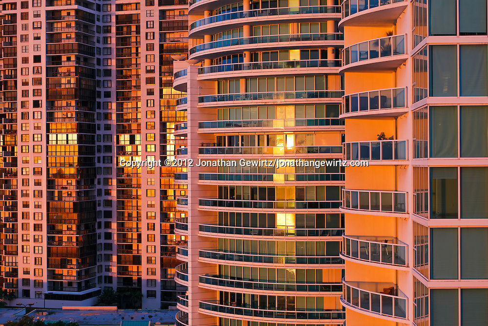 Miami, Florida condominium buildings reflect the warm light of the rising sun. WATERMARKS WILL NOT APPEAR ON PRINTS OR LICENSED IMAGES.