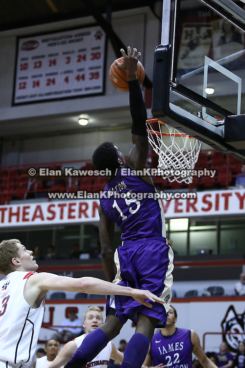 Andre Nation #15 of the James Madison University Dukes dunks the basketball during the game at Matthews Arena on January 29, 2014 in Boston, Massachusetts . (Photo by Elan Kawesch)