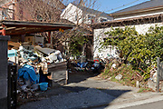 open garage parking messy storage by the house Japan