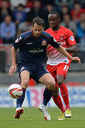 Walsall's Ben Purkiss and Leyton Orient's Moses Odubajo compete for the ball   - Photo mandatory by-line: Mitchell Gunn/JMP - Tel: Mobile: 07966 386802 29/09/2013 - SPORT - FOOTBALL -  Matchroom Stadium - London - Leyton Orient v Walsall - Sky Bet League One