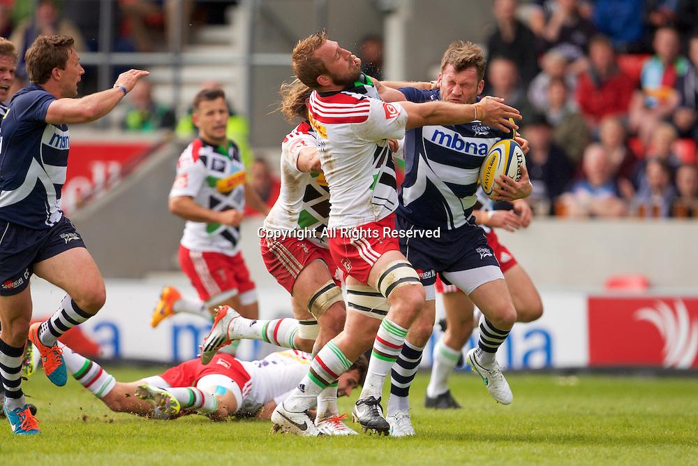 25.04.2015.  Sale, England.  Aviva Premiership Rugby. Sale Sharks versus Harstraight arm tackles Harlequins flanker Chris Robshaw.