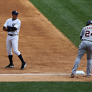 Alex Rodriguez, fielding at third base, talking with Miguel Cabrera on third during the New York Yankees V Detroit Tigers Major League Baseball regular season baseball game at Yankee Stadium, The Bronx, New York. 11th August 2013. Photo Tim Clayton