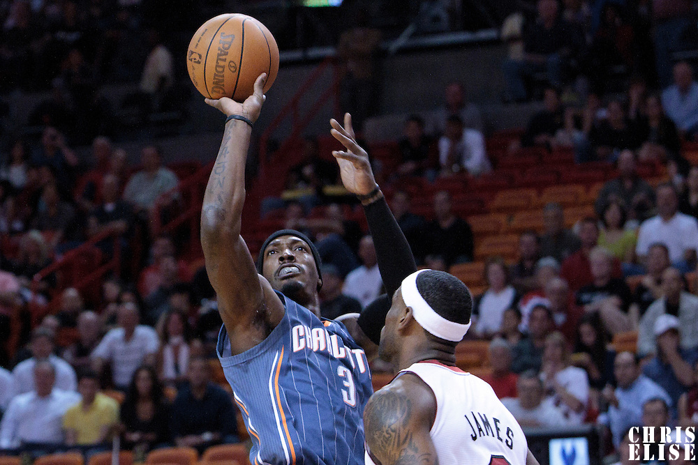 19 November 2010: Charlotte Bobcats' small forward #3 Gerald Wallace takes a jumpshot over Miami Heat's small forward #6 LeBron James during the Miami Heat 95-87 victory over the Charlotte Bobcats at the AmericanAirlines Arena, Miami, Florida, USA.