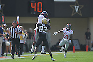 Ole Miss' Ja-Mes Logan (85) makes a catch over Vanderbilt defensive back Andre Hal (23) in Nashville, Tenn. on Saturday, September 17, 2011. Vanderbilt won 30-7..