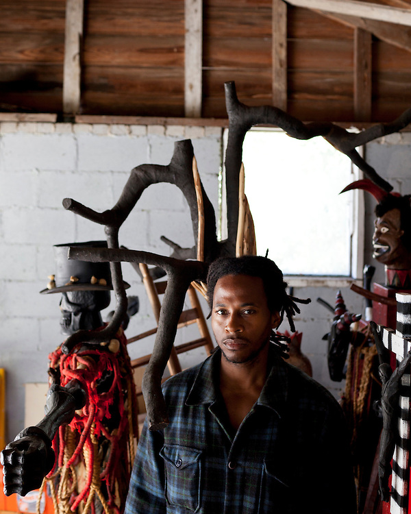 """Self-taught artist Odinga Tyehimba. His current project, Rebel Shrine, consists of various ritual power-figures which work in unison to form a visual commentary in contrast to the impact of cultural imperialism that stems from the Euro-centric worldview. Odinga's objective has been to inspire healing and self-realization through his work. Rebel Shrine has been chosen to be part of an upcoming show at The Gregg Museum of Art & Design at North Carolina State University. Glenn Hinson, Associate Professor of Folklore and Anthropology at University of North Carolina at Chapel Hill, has watched Odinga's work evolve for many years. He wrote """"Few artists create work that can truly be called """"monumental. Not merely in terms of size, but in terms of power, of its ability to challenge, to shake, to transform. Tyehimba is one such artist. For more than a decade, Odinga Tyehimba has been working on a single monumental piece, a multi-figured altar whose layered complexity speaks to cultural history, spiritual emergence, and personal growth. Each component of this masterwork tells a textured story, inviting viewers to confront the historical and spiritual realities of the African American experience."""