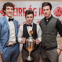 James Woods, Evan Courtney and Dara Walsh, members of the Éire Óg U21A Football Team receiving their medals on the night