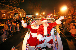 Mrs. Claus (Ethel Swan), left, and Santa (Jerry Swan) arrive at Gaslight Square to a crowd of about 150. (By Jonathan Palmer, Special to The Courier-Journal) December 6, 2008