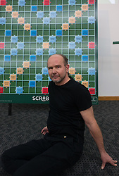 © Licensed to London News Pictures.03/11/2013. London, UK. Allan Simmons poses for a photograph during the final of The National Scrabble Championship against Paul Allan. Paul Allan, a teacher from Rushden, Northamptonshire, previously crowned champion in 2007 while Allan Simmons, a Scrabble consultant from Coldingham Village in the Scottish Borders, was previously crowned National Scrabble Champion in 2008. Photo credit : Peter Kollanyi/LNP