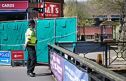 © Licensed to London News Pictures. 20/04/2018. Salisbury, UK. A police officer stands guard next to a new barrier erected near the area of The Maltings where the Skripals were found -  as a cleanup operation begins in Salisbury. Former Russian Spy Sergei Skripal and his daughter Yulia were poisoned using a nerve agent in the city last month. Experts have warned that 'Toxic levels' of the nerve agent novichok could still be present at hot spots around the city. Photo credit: Peter Macdiarmid/LNP
