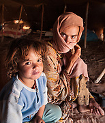 Deep in the Moroccan desert near the Algerian border I came upon 3 generations of a Berber family living in isolation. A grandmother, mother and child who kindly invited me into their tent for tea.