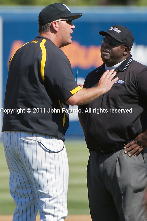 Head Coach Troy Buckley argues with Dwayne Finley in the Big West Conference game against Cal Poly at Blair Field, Long Beach, Calif., Sunday, May 1, 2011.