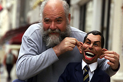Sothebys to sell cast of satirical TV show Spitting Image. Photo shows one of the creators Roger Law with Tony Blair, July 7, 2000. Photo by Andrew Parsons / i-images...spain out