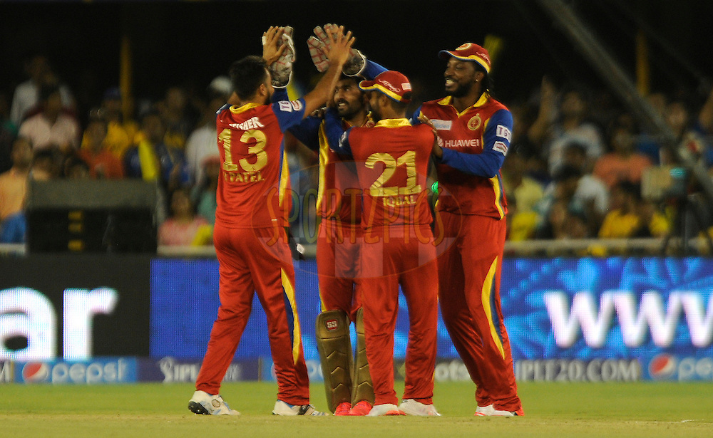 Dinesh Karthik of Royal Challengers Bangalore celebrates the wicket of James Faulkner of Rajasthan Royals during match 22 of the Pepsi IPL 2015 (Indian Premier League) between The Rajasthan Royals and The Royal Challengers Bangalore held at the Sardar Patel Stadium in Ahmedabad , India on the 24th April 2015.<br /> <br /> Photo by:  Pal Pillai / SPORTZPICS / IPL