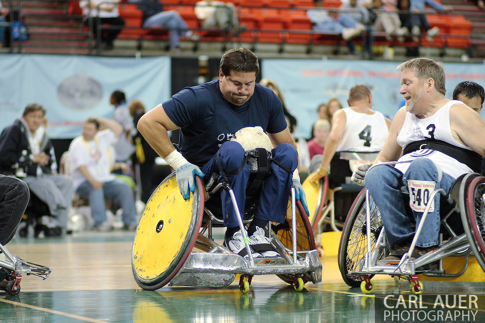 July 7th, 2006: Anchorage, AK - Scot Severn muscles into score past the White team and Gustave Sorenson (3) as White went on to defeat Blue in the gold medal game of Quad Rugby at the 26th National Veterans Wheelchair Games.