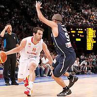 15 July 2012: Jose Calderon of Team Spain drives past Tony Parker of Team France during a pre-Olympic exhibition game won 75-70 by Spain over France, at the Palais Omnisports de Paris Bercy, in Paris, France.