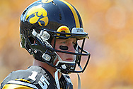 August 31 2013: Iowa Hawkeyes quarterback Jake Rudock (15) warms up with his team before the start of the NCAA football game between the Northern Illinois Huskies and the Iowa Hawkeyes at Kinnick Stadium in Iowa City, Iowa on August 31, 2013. Northern Illinois defeated Iowa 30-27.