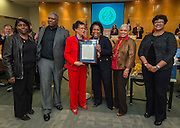 Houston ISD Board of Trustees member Paula Harris recognizes former Yates High School football coach and Texas Black Sports Hall of Fame inductee Luther Booker by pressnting a proclamation to his widow, Clairene Booker, during the Board of Trustees meeting, February 12, 2015.