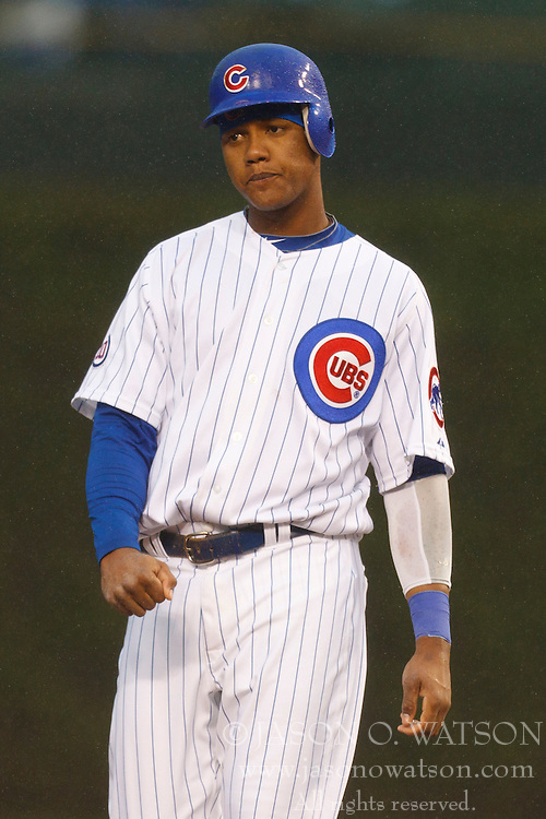 May 14, 2011; Chicago, IL, USA;  Chicago Cubs shortstop Starlin Castro (13) stands on second base during the first inning against the San Francisco Giants at Wrigley Field.  San Francisco defeated Chicago 3-0 in a rain shortened game.