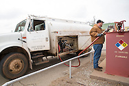 Filling the on farm diesel tank used for agricultural equipment.