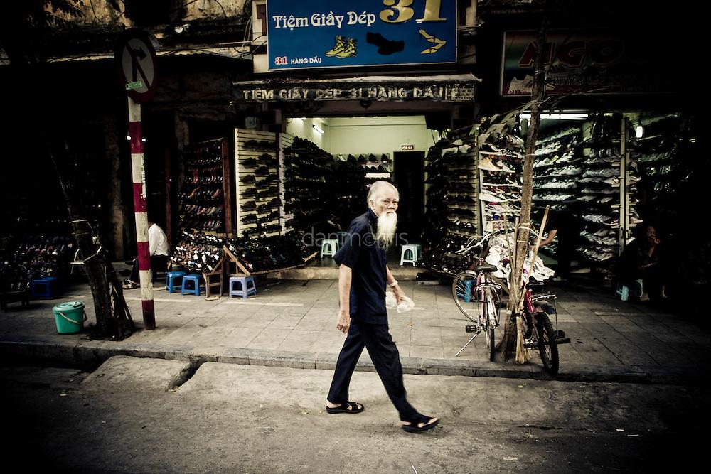 Elderly man strolls through the French Quarter, Hanoi, Vietnam