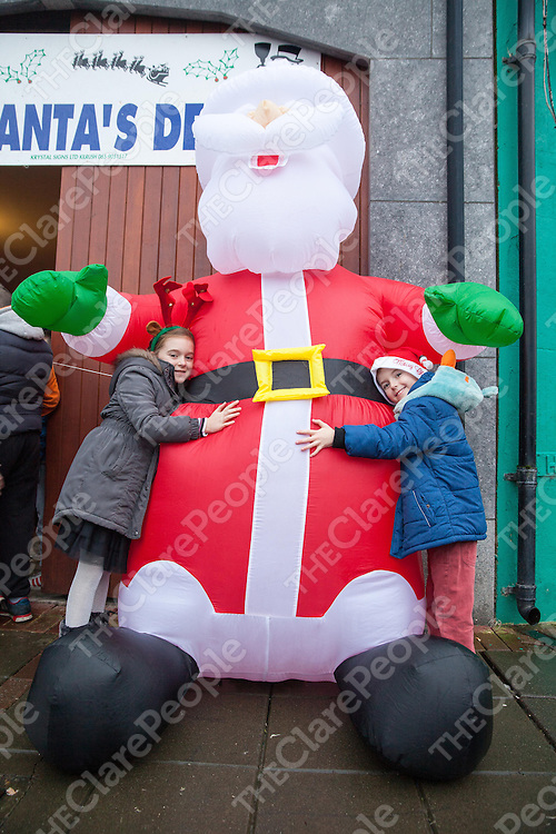Roisín and Conor Troy visiting Santa during his visit to Kilrush to turn ont he Chritmas lights