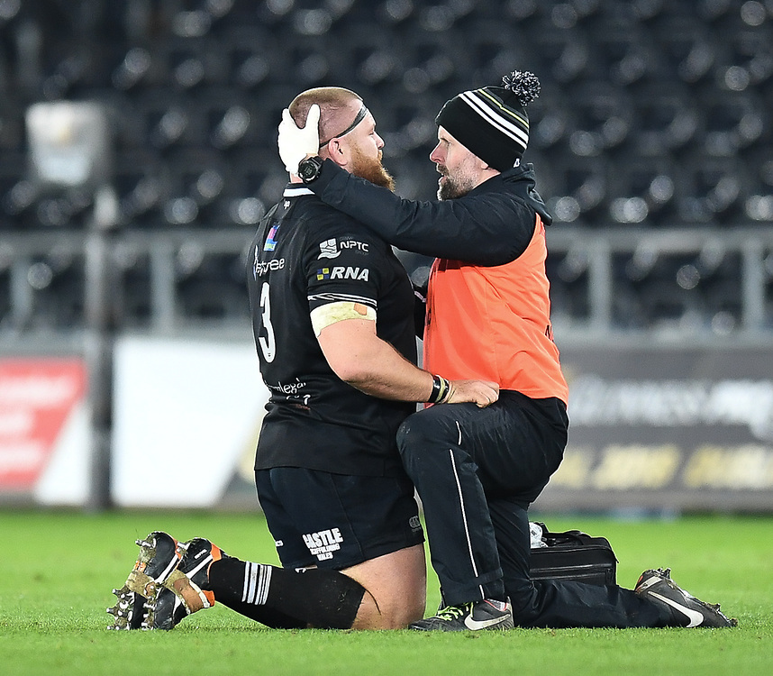 Ospreys' Dimitri Arhip having treatment during todays match<br /> <br /> Photographer Mike Jones/Replay Images<br /> <br /> Guinness PRO14 Round Round 16 - Ospreys v Cheetahs - Saturday 24th February 2018 - Liberty Stadium - Swansea<br /> <br /> World Copyright © Replay Images . All rights reserved. info@replayimages.co.uk - http://replayimages.co.uk