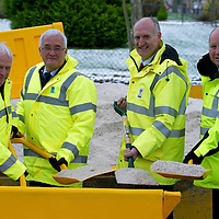 Communities in Perth & Kinross encouraged to use grit bins to help reduce impact of snow & ice....06.12.11   From left Cllrs Ian Miller and John Kellas are joined by Adam Olejnik Head of Public Space Management and Chic Haggart Roads Manager at the site of a new 'grit bin' on Struan Road in Perth. The council are urging residents to use salt from their nearest grit bins to treat non-priority roads and public footways.<br /> Picture by Graeme Hart.<br /> Copyright Perthshire Picture Agency<br /> Tel: 01738 623350  Mobile: 07990 594431