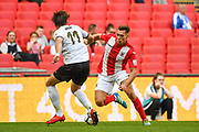 Adam Mekki of Bromley FC (11) and Matt Lowe of Brackley Town (2) in action during the FA Trophy match between Brackley Town and Bromley at Wembley Stadium, London, England on 20 May 2018. Picture by Stephen Wright.