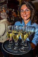 Serving champagne on the Wilderness Explorer (small cruise ship) , Inside Passage, Southeast Alaska USA.