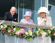 © Licensed to London News Pictures. 07/06/2014. Epsom, UK. HRH HRH Prince Philip The Duke of Edinburgh and Queen Elizabeth II watche the Derby from the balcony of the grandstand whilst talking to Princess Michael of Kent . Derby Day today 7th June 2014 at Epsom 2014 Investic Derby Festival in Surrey. Traditionally, elegant, fashionable racegoers gather for a classic day's racing at Epsom Racecourse, Surrey. Photo credit : Stephen Simpson/LNP