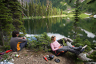 Waterton National Park, Alberta, Canada, July 2008. Campers at Lone Lake campsite relax after a day of hiking. The Tamarack trail is a multiple day hike in the Rocky Mountains. Photo by Frits Meyst/Adventure4ever.com