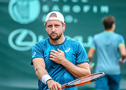 April 13, 2018 - Houston, TX, U.S. - HOUSTON, TX - APRIL 13:  Tennys Sandgren of the United States prepares to serve in the match against Guido Pella of Argentina during the Quarterfinal round of the Men's Clay Court Championship on April 13, 2018 at River Oaks Country Club in Houston, Texas.  (Photo by Leslie Plaza Johnson/Icon Sportswire) (Credit Image: © Leslie Plaza Johnson/Icon SMI via ZUMA Press)