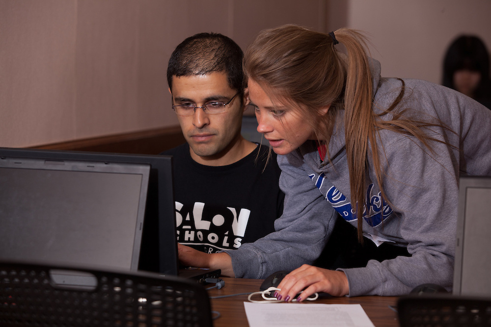 Student volunteer Sarah Weisenberger (Right) assists international student Ahmad Al- Tarawnah complete his tax forms at a volunteer income tax assesment program offered by the College of Business at Ohio University.