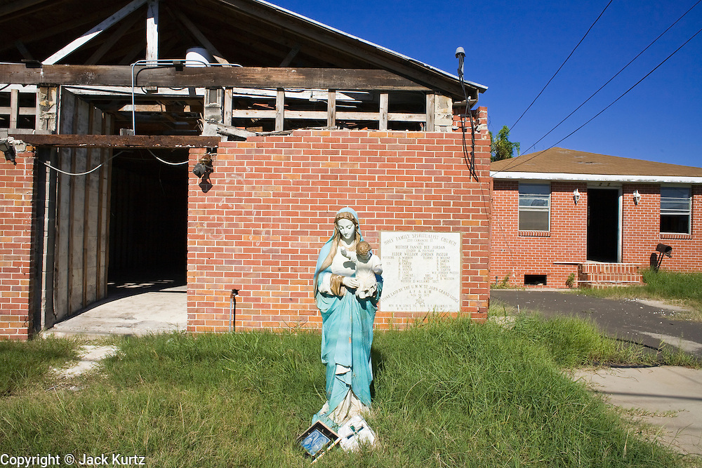 20 SEPTEMBER 2006 - NEW ORLEANS, LOUISIANA: A statue of the Virgin Mary and Baby Jesus in front of the Holy Family Spiritualist Church on LaManche Street in the Lower 9th Ward of New Orleans, LA. The neighborhood was abandoned after flooding from nearby canals after Hurricane Katrina inundated this part of the city.  Photo by Jack Kurtz / ZUMA Press