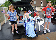 From left, Karen Vonsydow, Cecilia Schilk, 95 years old and Ceil Dixon wave American flags during the Lower Southampton Independence Day Parade Saturday July 4, 2015 in Feasterville, Pennsylvania. (Photo by William Thomas Cain)