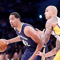 07 December 2014: New Orleans Pelicans center Alexis Ajinca (42) drives past  Los Angeles Lakers center Robert Sacre (50) during the New Orleans Pelicans 104-87 victory over the Los Angeles Lakers, at the Staples Center, Los Angeles, California, USA.