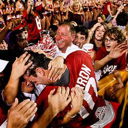 November 3, 2012; Baton Rouge, LA, USA; Alabama Crimson Tide quarterback AJ McCarron (10) celebrates with fans in the stands following a win over the LSU Tigers in a game at Tiger Stadium. Alabama defeated LSU 21-17. Mandatory Credit: Derick E. Hingle-US PRESSWIRE